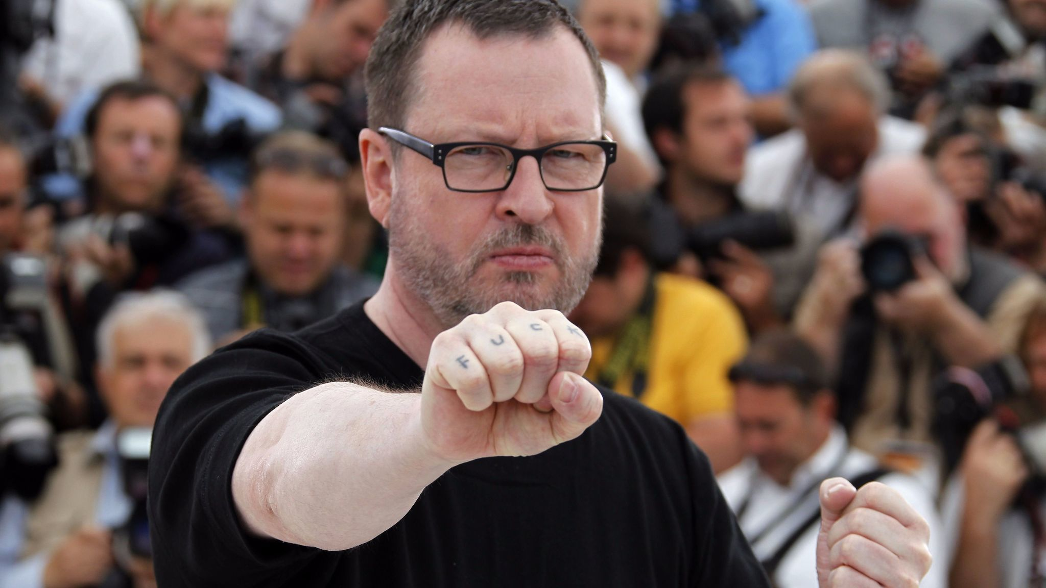 "Danish director Lars von Trier at the 64th Cannes Film Festival on May 18, 2011, showing his tattoo while promoting ""Melancholia."" (Francois Guillot / AFP/Getty Images)"