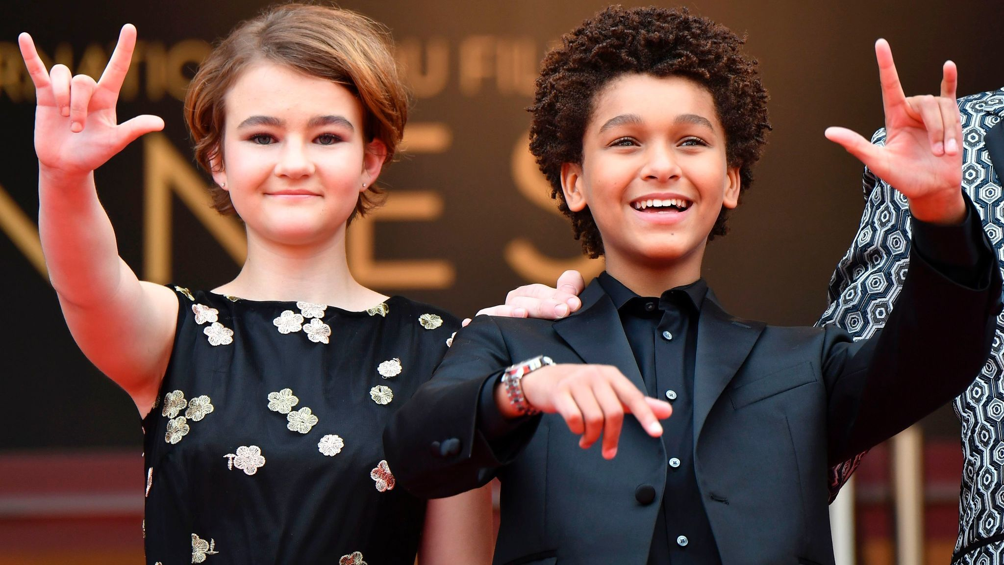 "Millicent Simmonds, left, and Jaden Michael arrive for the screening of their film ""Wonderstruck"" at the Cannes Film Festival."