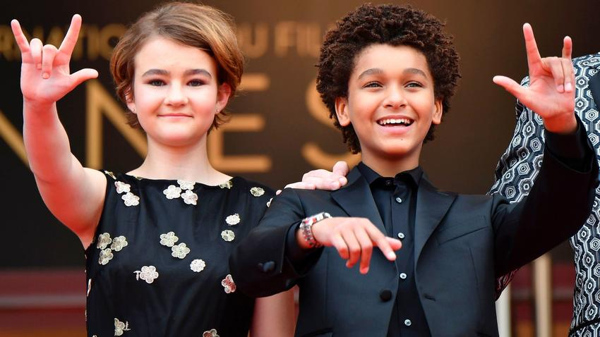"Millicent Simmonds, left, and Jaden Michael arrive for the screening of their film ""Wonderstruck"" at the Cannes Film Festival. (Alberto Pizzoli / AFP/Getty Images)"