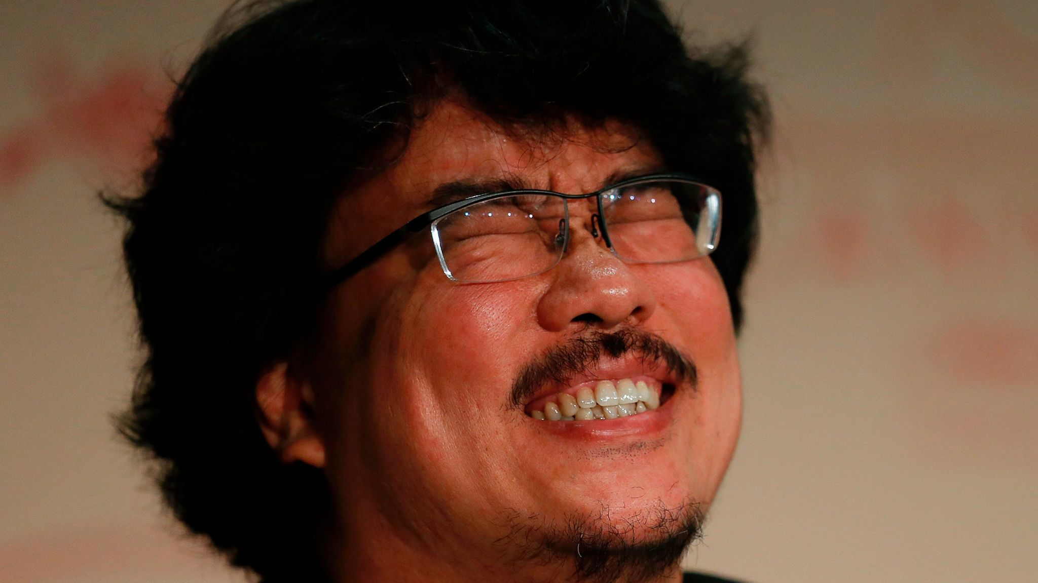 South Korean director Bong Joon-ho reacts during a May 19 conference for the film 'Okja' at the Cannes Film Festival. (Laurent Emmanuel / AFP/Getty Images)