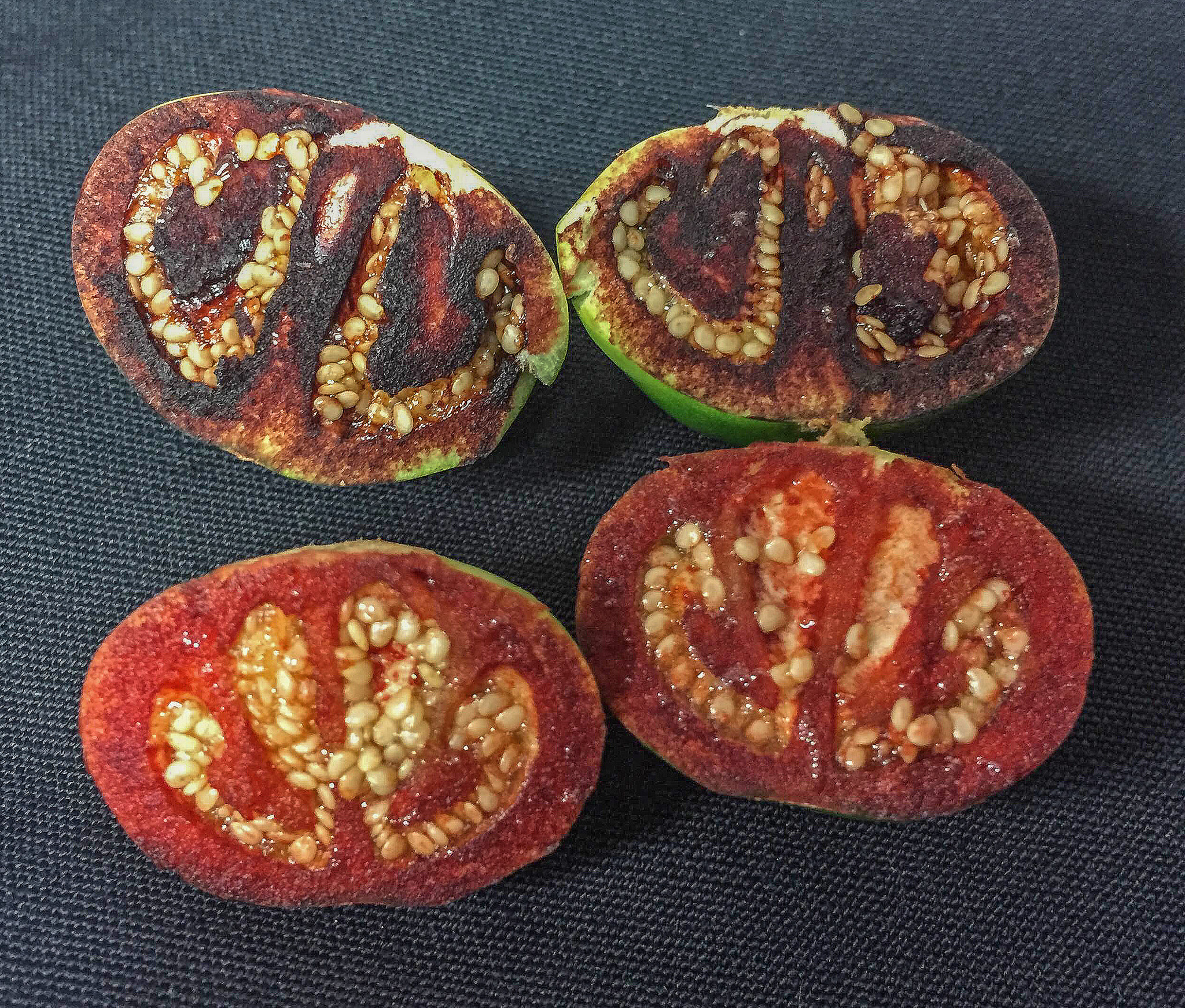 Unripened fruit turns blood red after being cut.