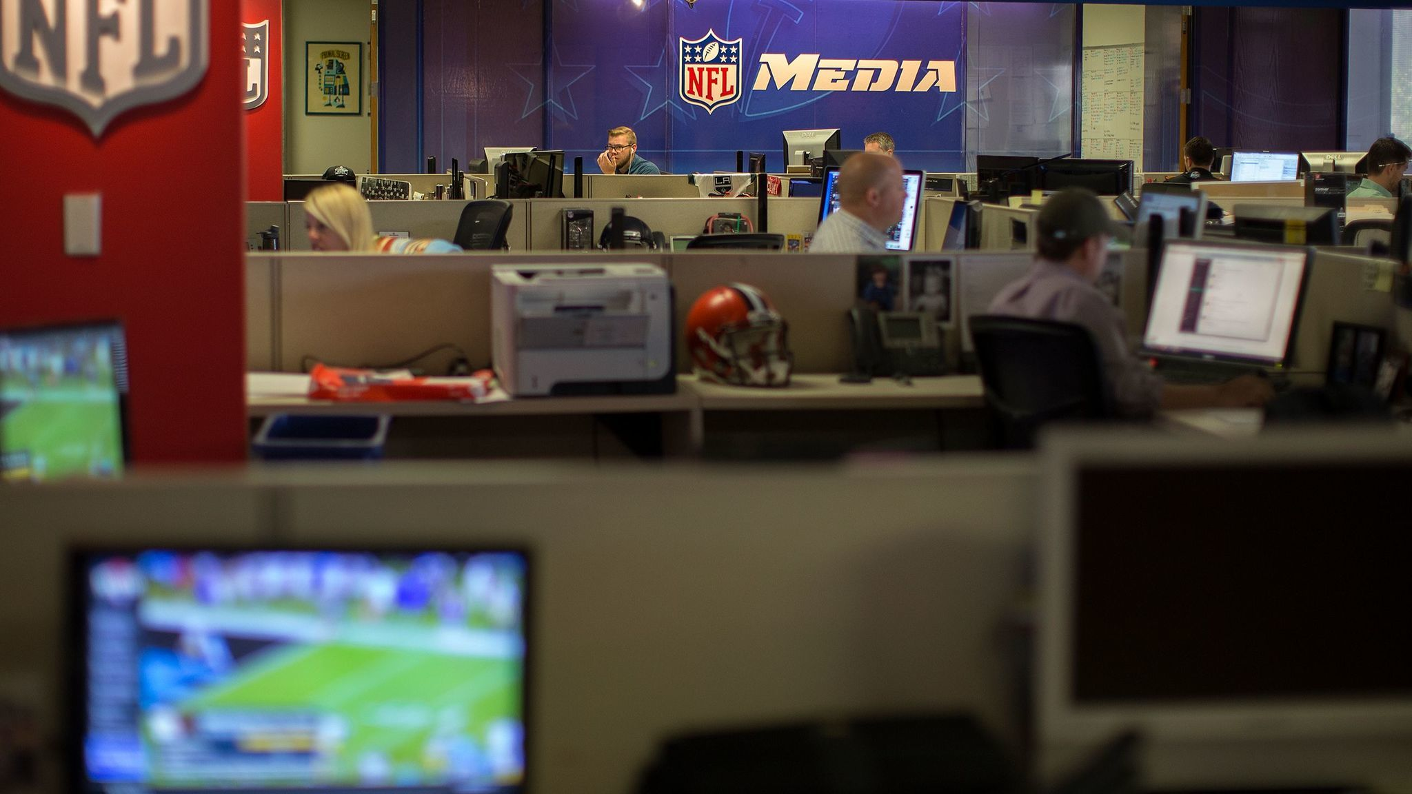 Employees at NFL Digital Media work in the newsroom on in 2015 in Culver City. People working in information businesses have seen among the biggest pay increases since last April.