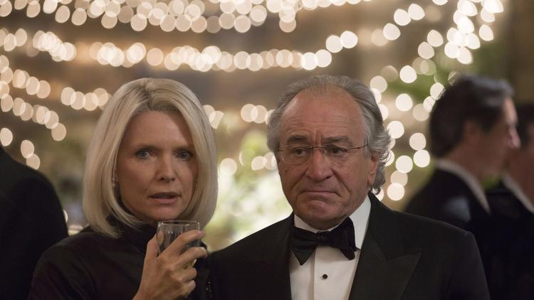 This image released by HBO shows Michelle Pfeiffer as Ruth Madoff, left, and Robert De Niro as Berni