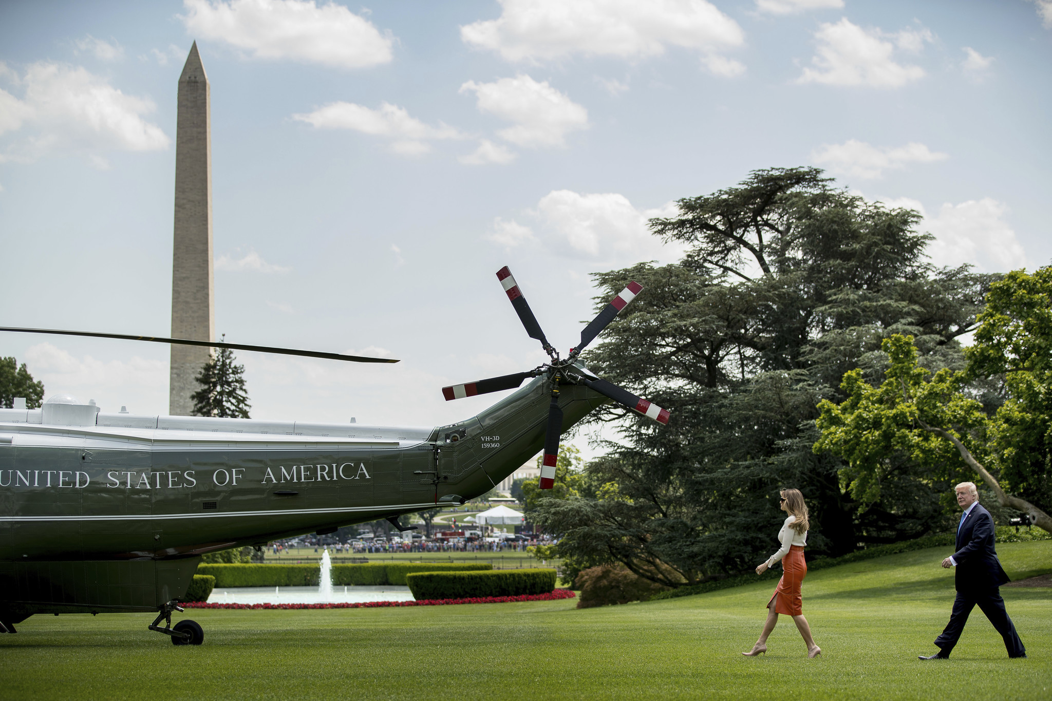 President Trump and First Lady Melania Trump walk across the South Lawn of the White House on Friday, May 19, before boarding Marine One for a short trip to Joint Base Andrews in Maryland. (Andrew Harnik / Associated Press)