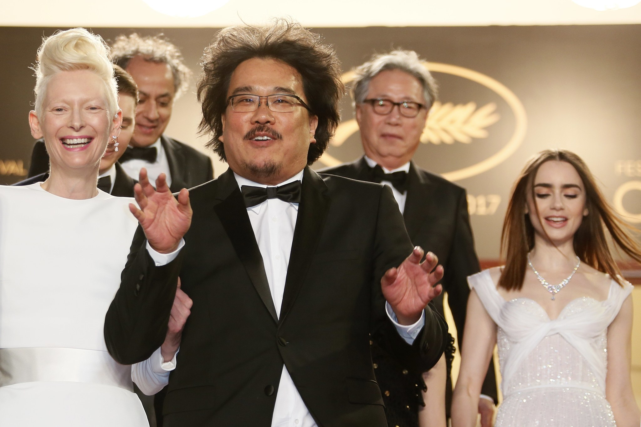 Actress Tilda Swinton, director Bong Joon-ho, actor Byung Heebong and actress Lily Collins at the premiere of 'Okja' during the 70th annual Cannes Film Festival.