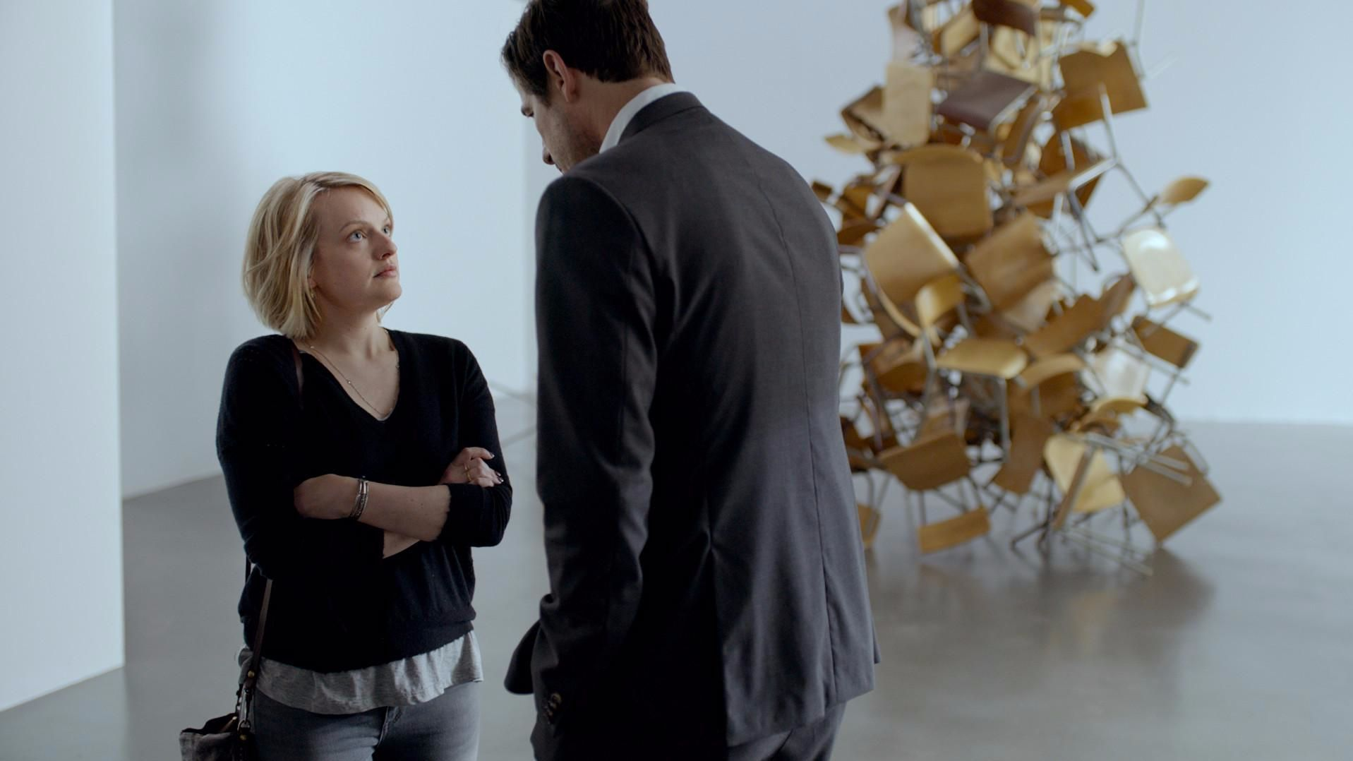 "Elisabeth Moss and Claes Bang in the film ""The Square."""
