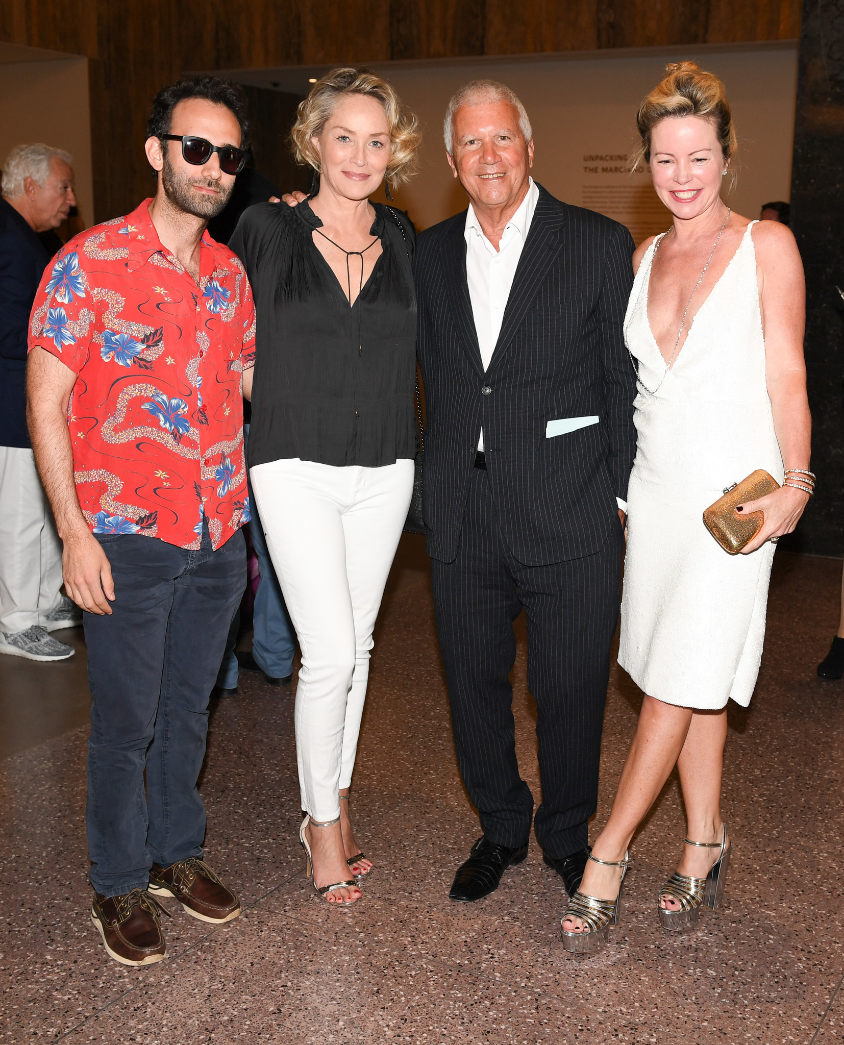 Artist Alex Israel, Sharon Stone and art dealers Larry Gagosian and Chrissie Erpf.