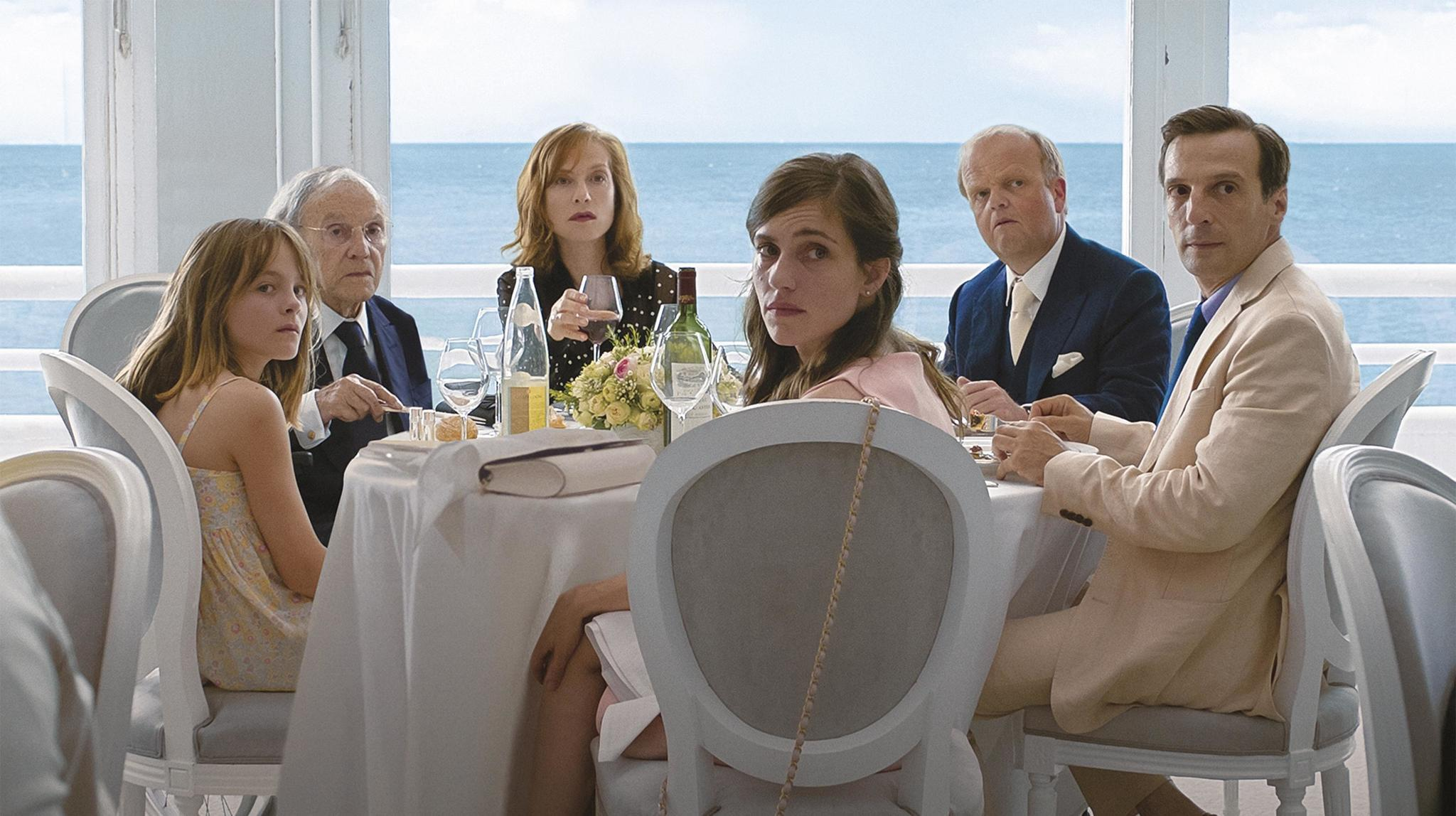 "Fantine Harduin, Jean-Louis Trintignant, Isabelle Huppert, Laura Verlinden, Toby Jones and Mathieu Kassovitz in the film ""Happy End."""
