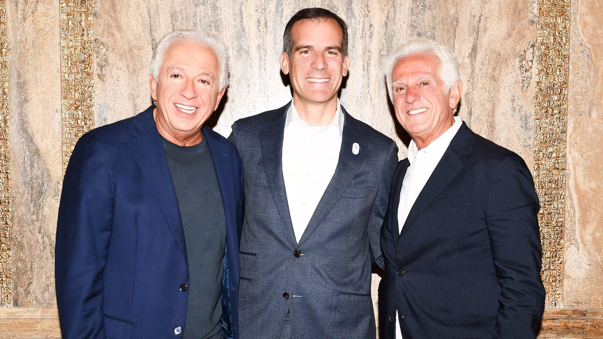 Los Angeles Mayor Eric Garcetti with Paul Marciano, left, and Maurice Marciano.