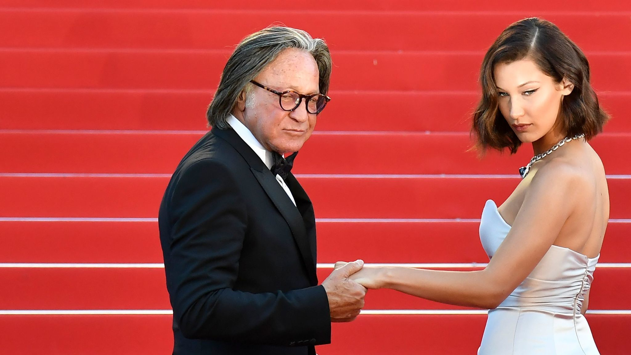 "Mohamed Hadid and his daughter, model Bella Hadid, arrive for the screening of the film ""Ismael's Ghosts"" at the Cannes Film Festival in southern France this month."