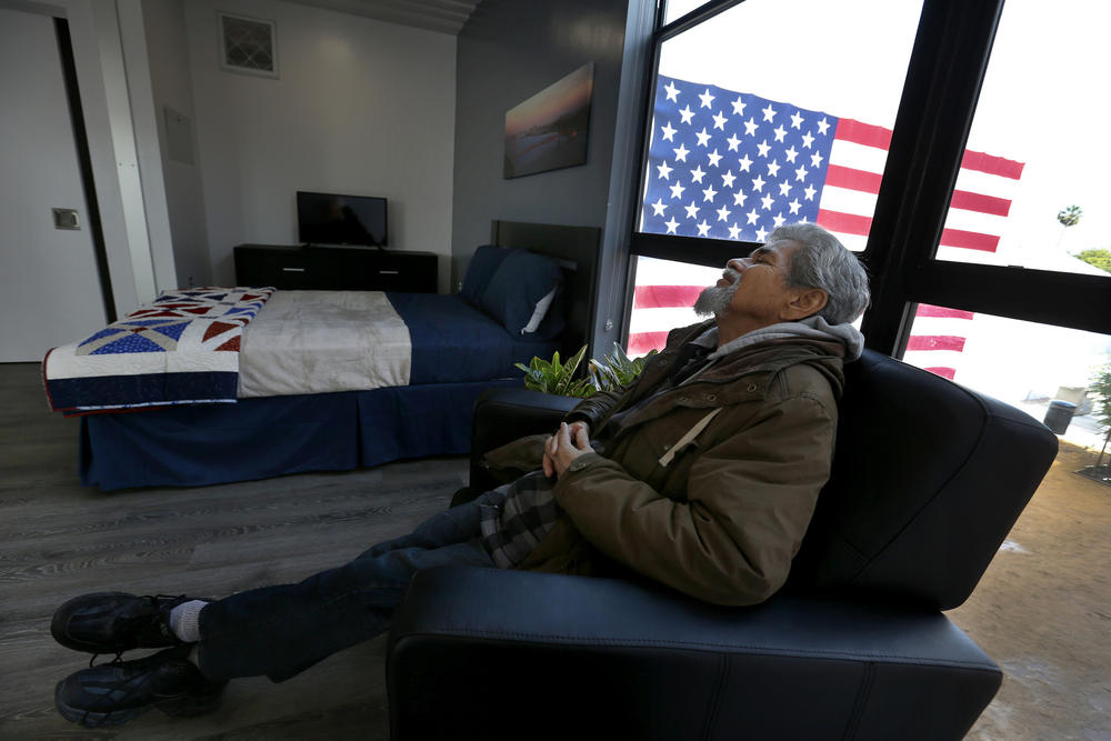 After the grand opening crowds have left, homeless Army veteran Kenneth Salazar, 60, relaxes in a new chair in his new studio apartment.