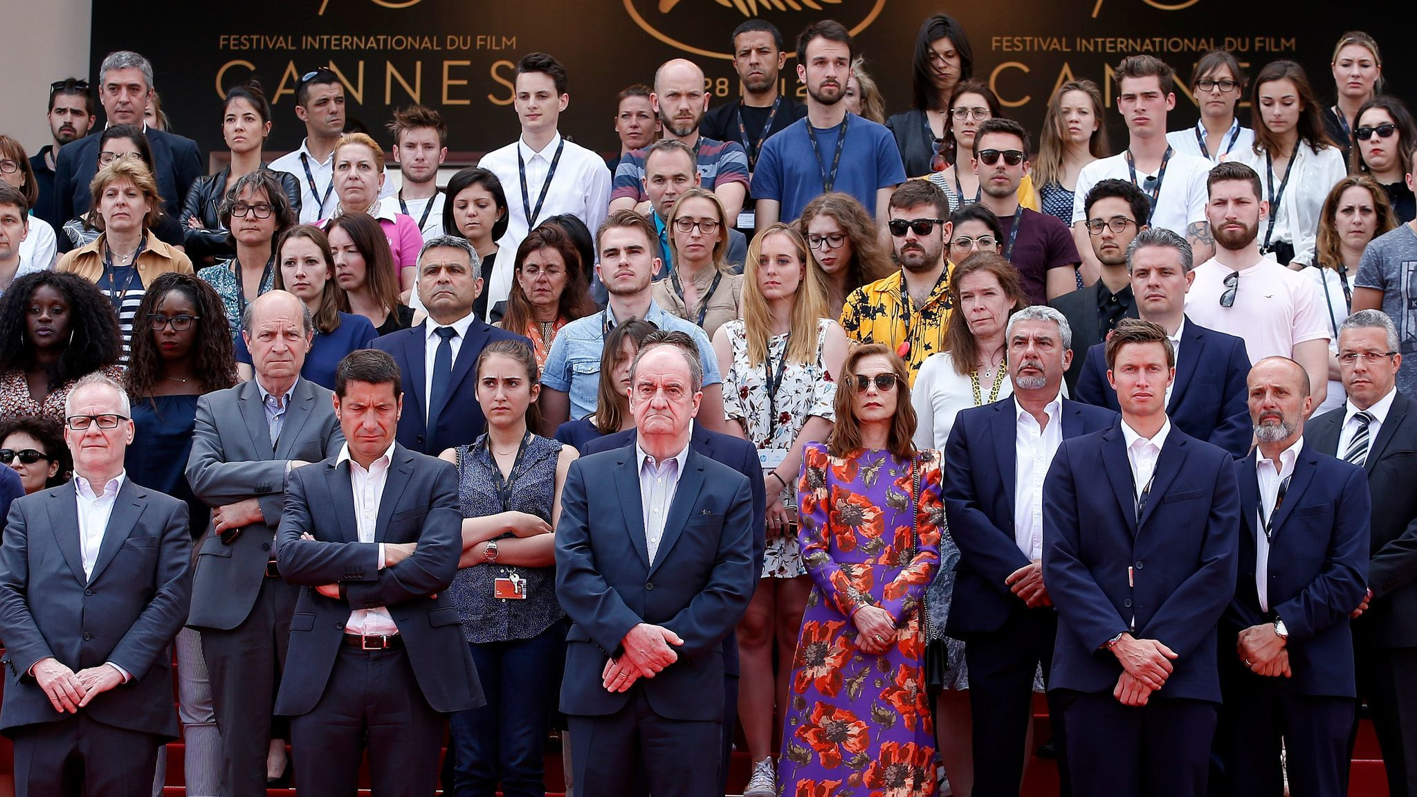 A moment of silence at Cannes for Manchester: Front row, from left, festival director Thierry Fremaux, Cannes Mayor David Lisnard, festival President Pierre Lescure, actress Isabelle Huppert and staff.