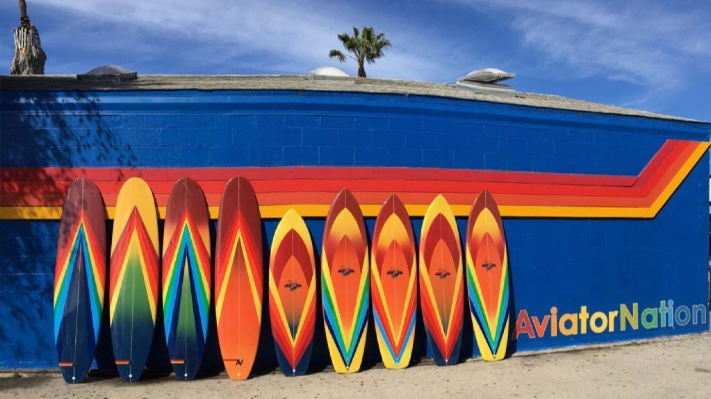 Aviator Nation limited-edition, signed and numbered surfboards designed by Paige Mycoskie, hand-shaped by Bruce Fowler and airbrushed by Bob Haakenson sell for $1,500 each.