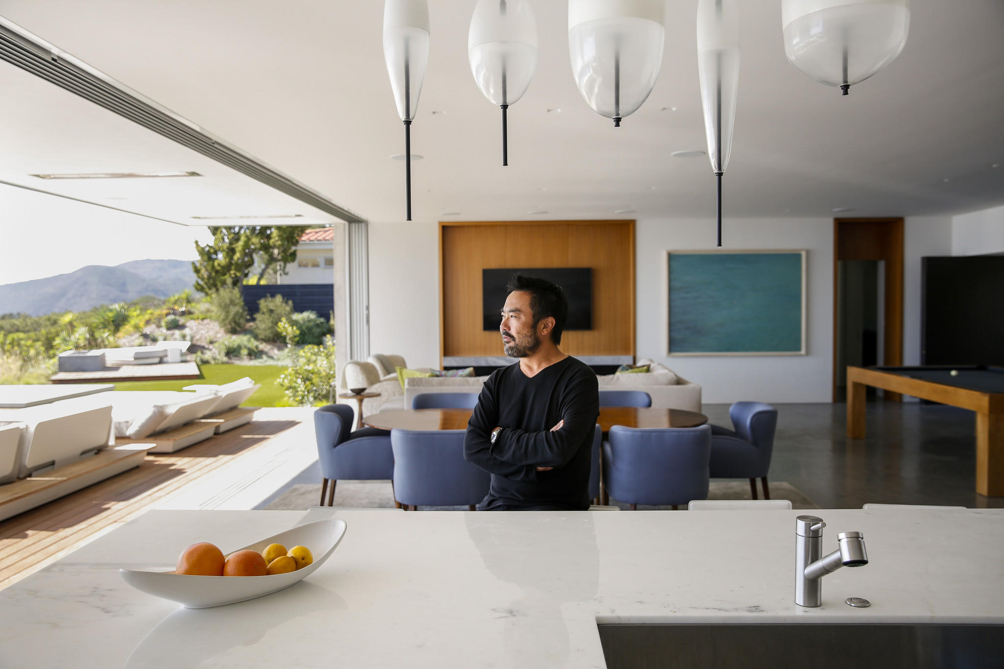 Takashi Yanai, FAIA design director of the residential studio at the firm Ehrlich Yanai Rhee Chaney Architects, sits for a portrait inside his recent remodel.