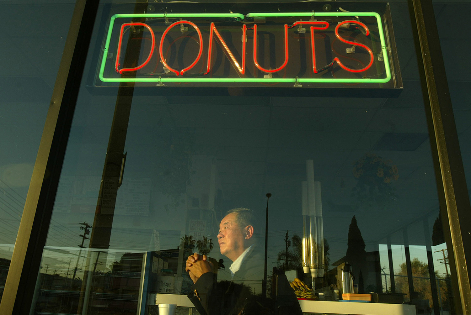 Ted Ngoy sits inside a Christy's Donut Shop, which he built in the mid-1980s, in Hawthorne in 2004.