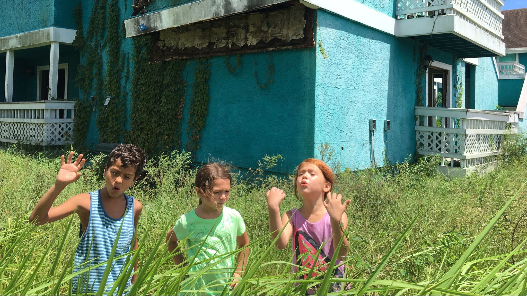 "Christopher Rivera, Brooklynn Prince and Valeria Cotto in the film ""The Florida Project."""