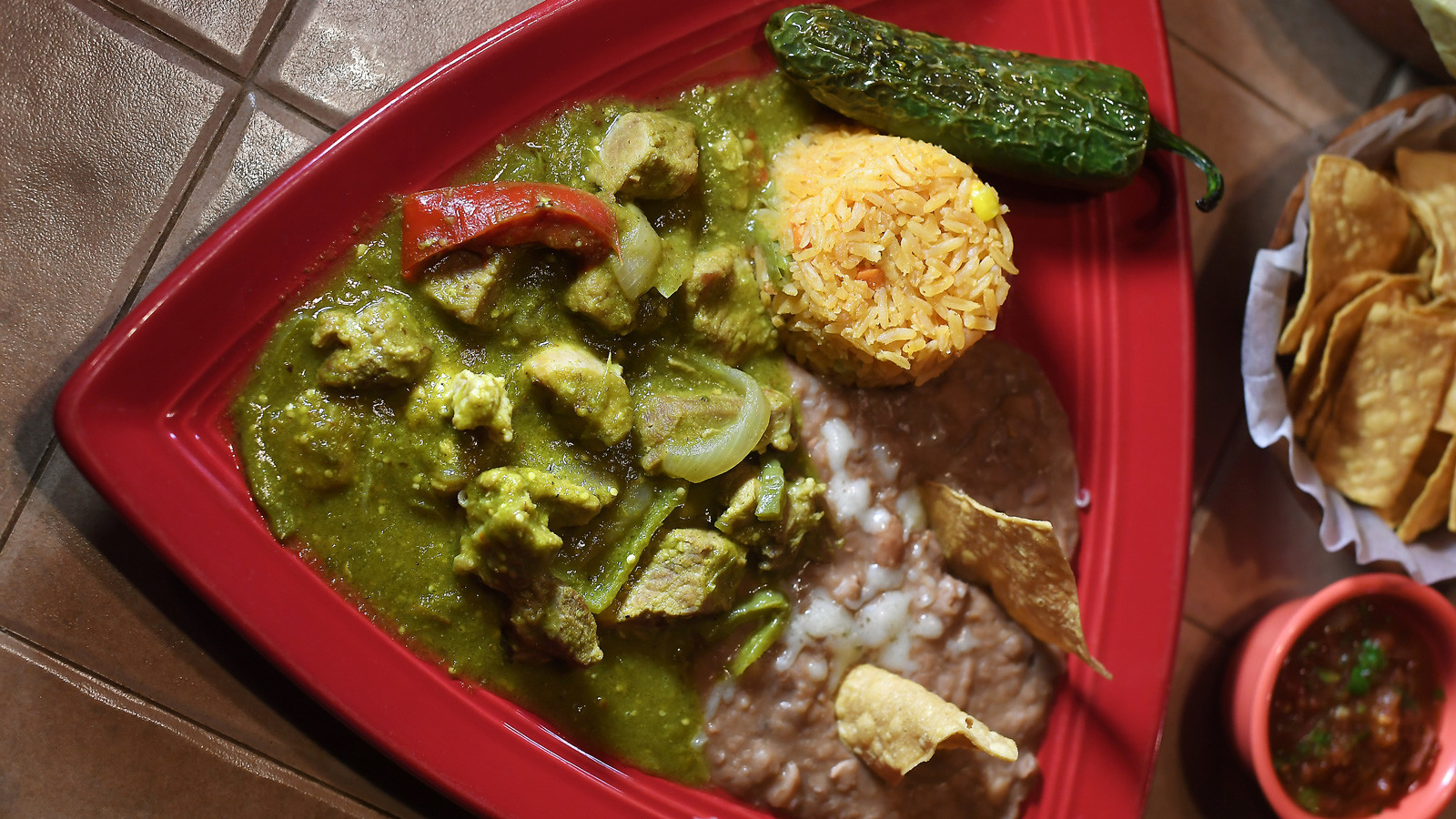 Chile verde -- pork simmered in green sauce -- is served with rice and beans at Chalio Mexican Restaurant in Los Angeles.