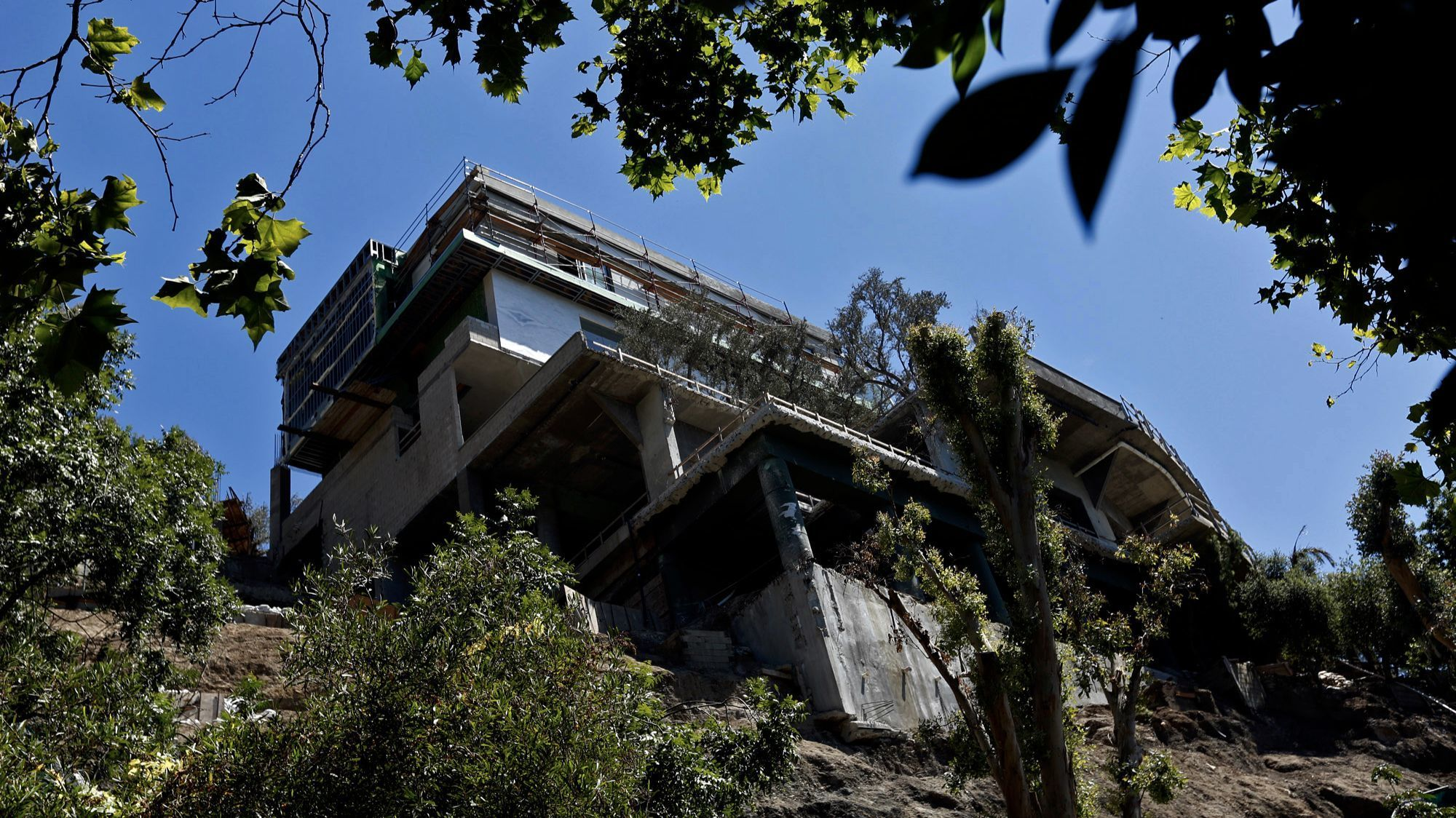 Three years ago, Los Angeles demanded that builders halt work on this mansion in the hills of Bel-Air.