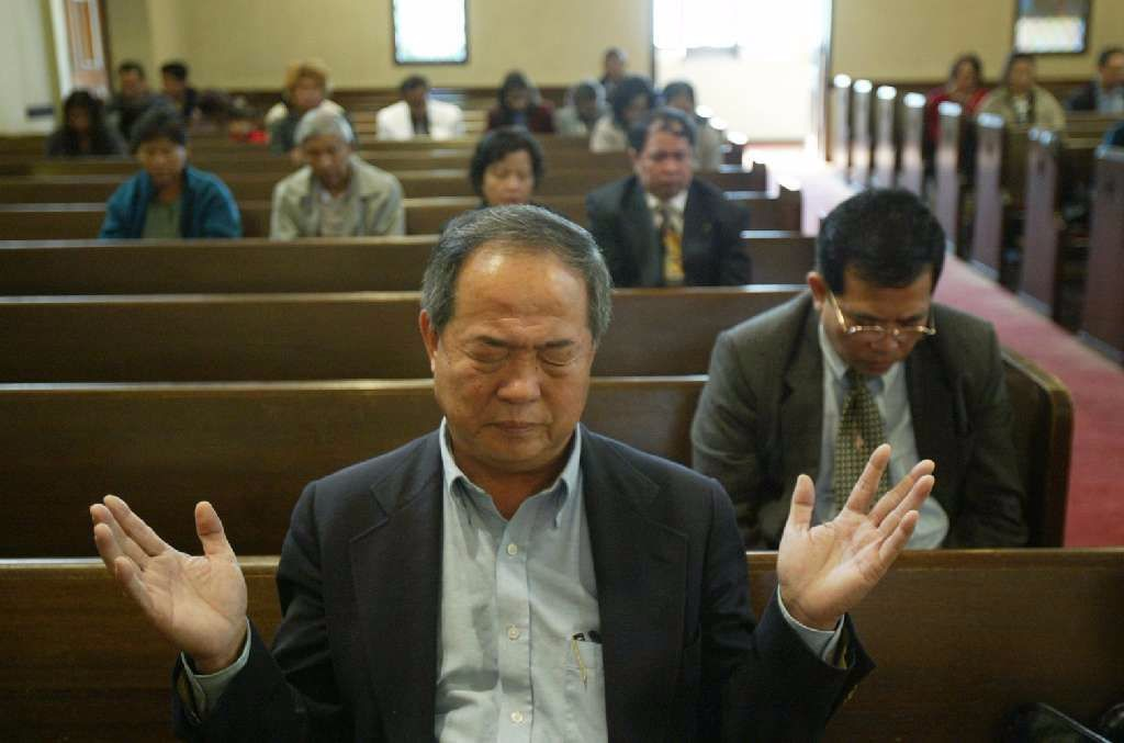 Ted Ngoy worships at the East Side Christian Church in Long Beach in November 2004.