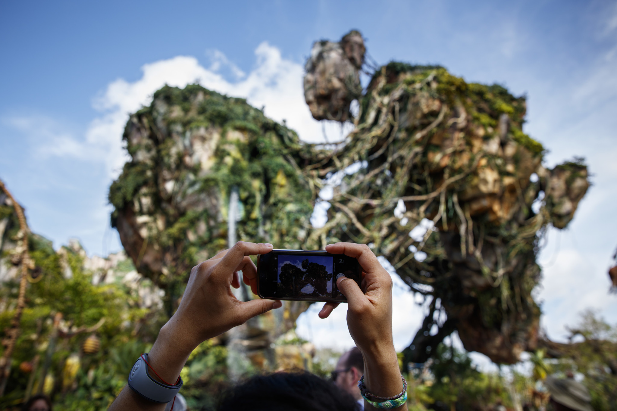 """A visitor takes a photo of the floating mountains of Pandora. Click to see more photos from inside Disney's new """"Avatar""""-inspired Pandora park in Orlando, Fla."""