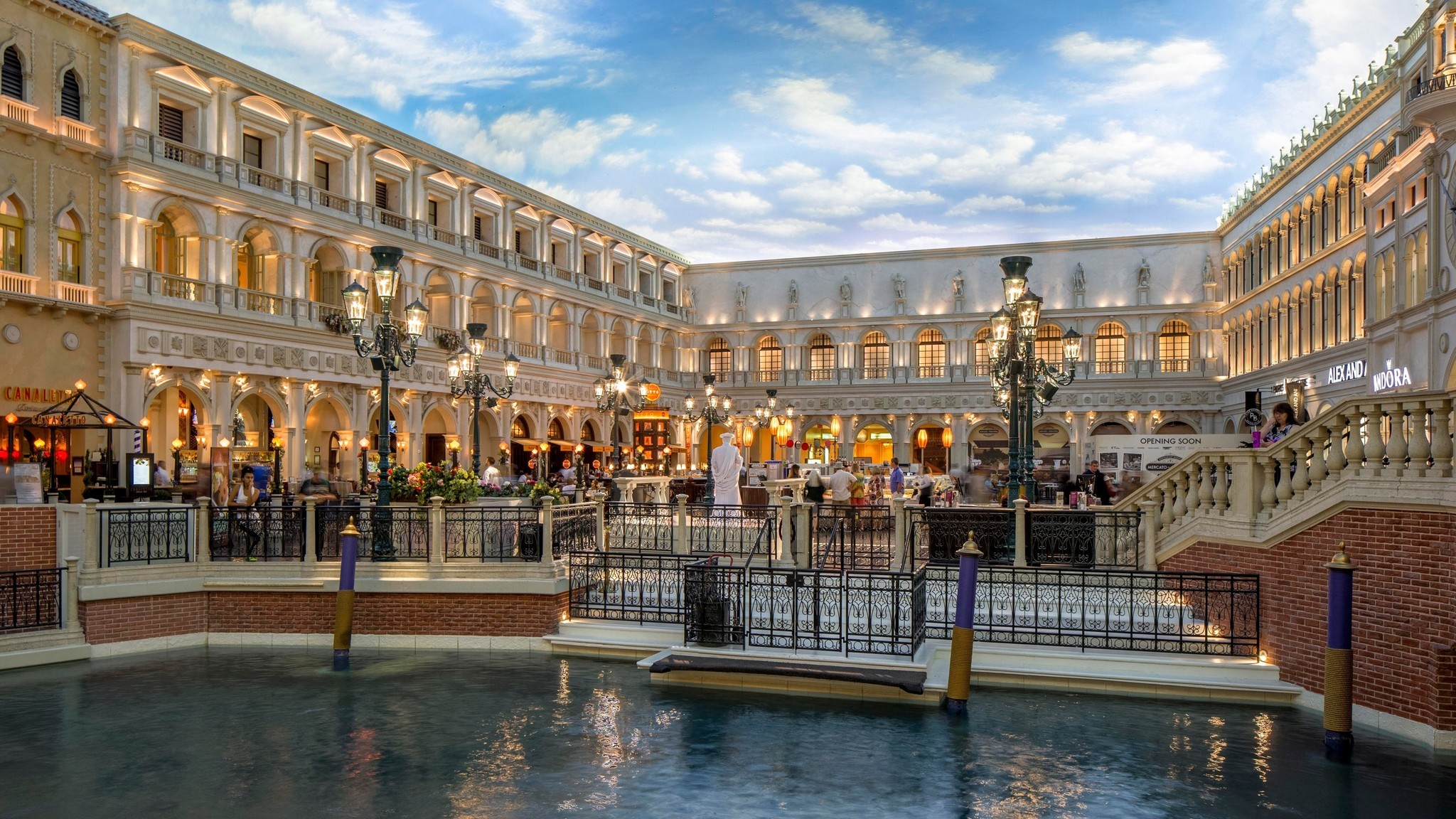 The Forum Shops' success led the way for other themed shopping centers at resorts along the Strip. At the Venetian, the Grand Canal Shoppes opened in 1999, offering guests an opportunity to float past stores in gondolas.