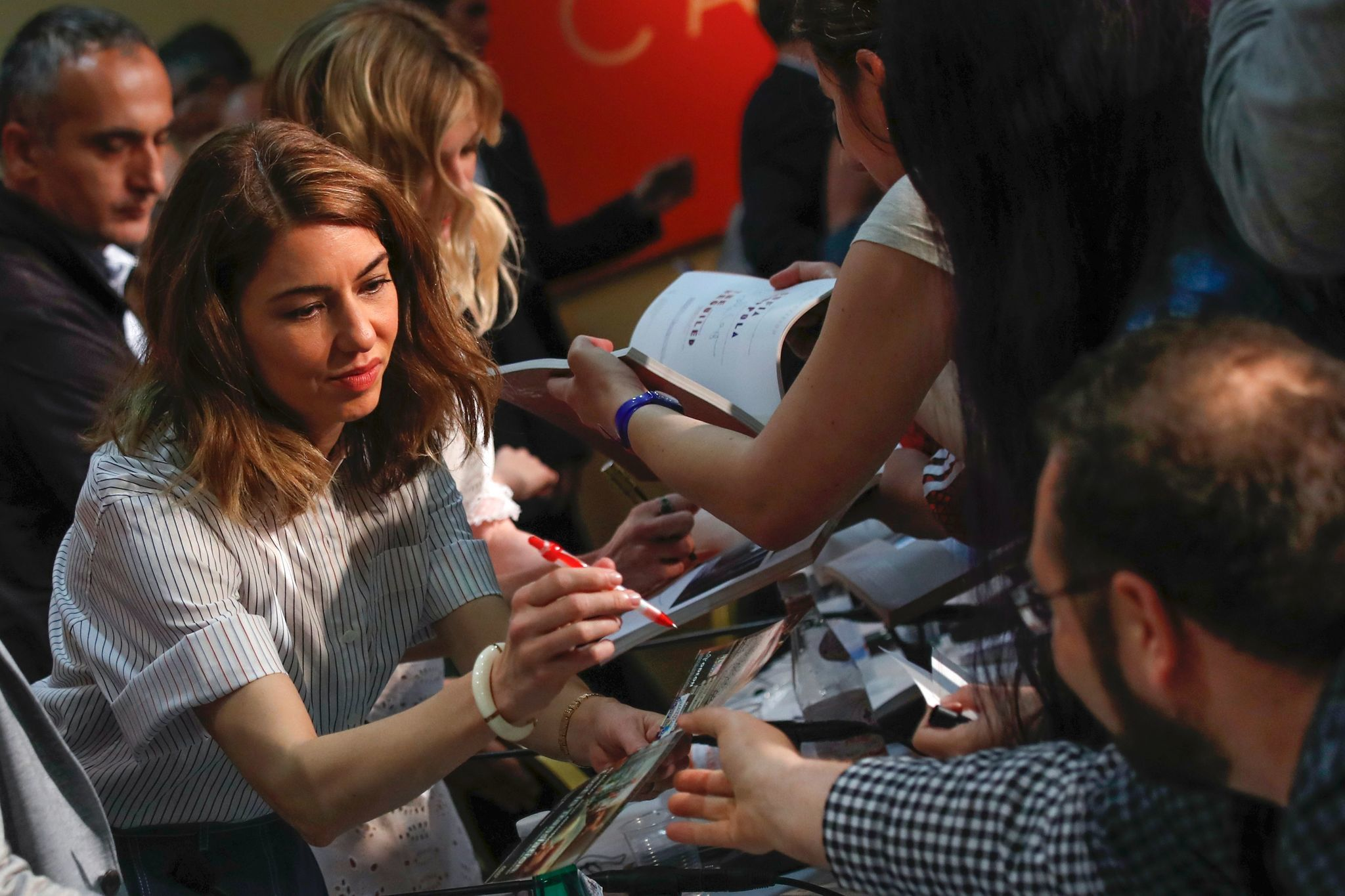 "Director Sofia Coppola signs autographs on Wednesday after a press conference for her film ""The Beguiled"" at the 70th edition of the Cannes Film Festival."