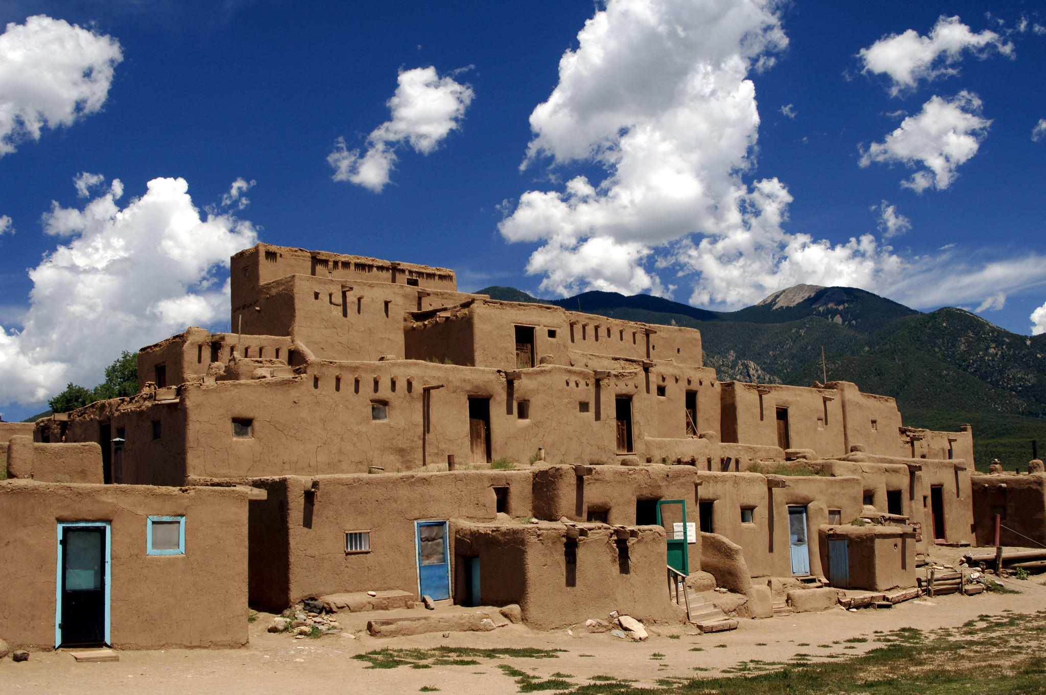 Adobe buildings in Taos Pueblo, inhabited by Tiwa Indians of the Pueblo tribe, in New Mexico is a UNESCO World Heritage Site. (Phas / UIG via Getty Images)