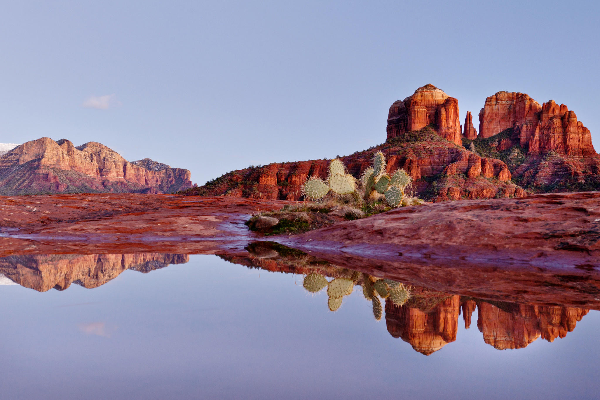 Cathedral rock is reflected in a rain pool. (Dougberry / Getty Images)