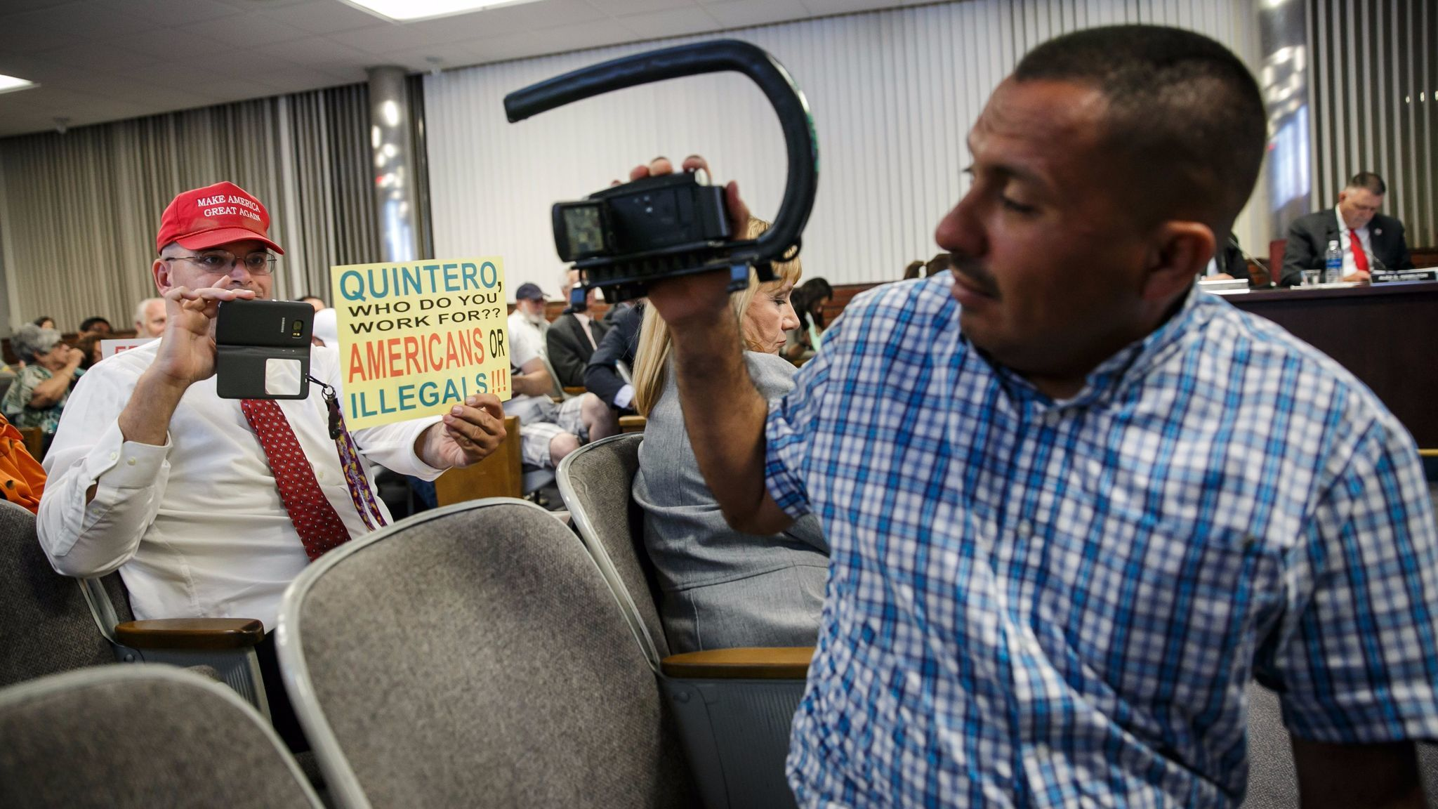 Schaper and immigrants' rights activist Naui Huitzilopochtli point their cameras at each other. Huitzilopochtli, of Santa Ana, often shows up at events specifically to record Schaper and other anti-illegal immigrant activists.