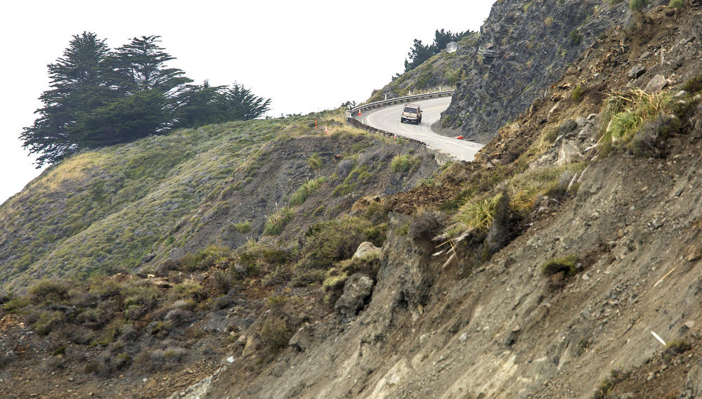 A southbound motorist turns around after hitting a dead end on Highway 1, where a massive landslide cut off the road north of Ragged Point in Monterey County.
