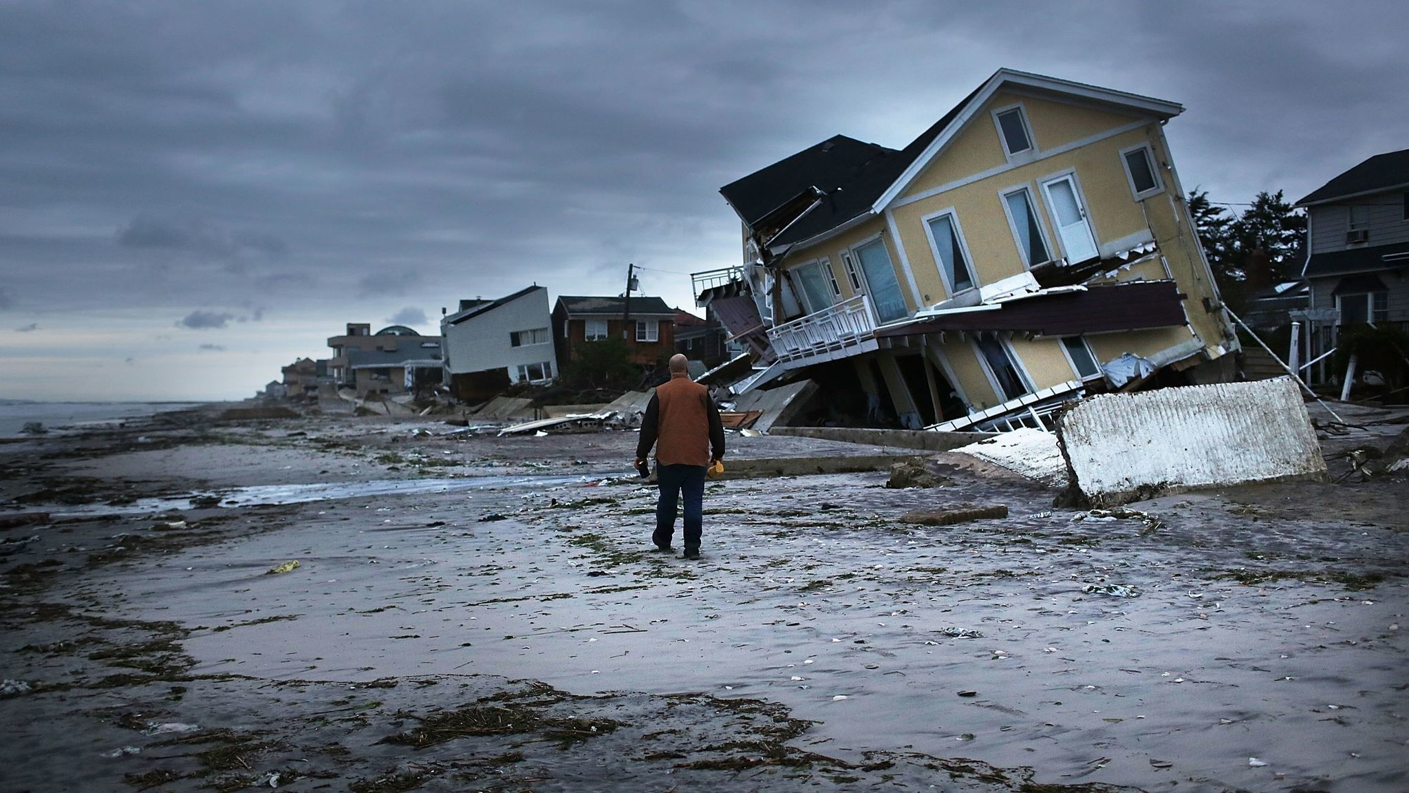 Damage is viewed in the Rockaway neighborhood of the Queens borough of New York City, where the historic boardwalk was washed away during Hurricane Sandy.