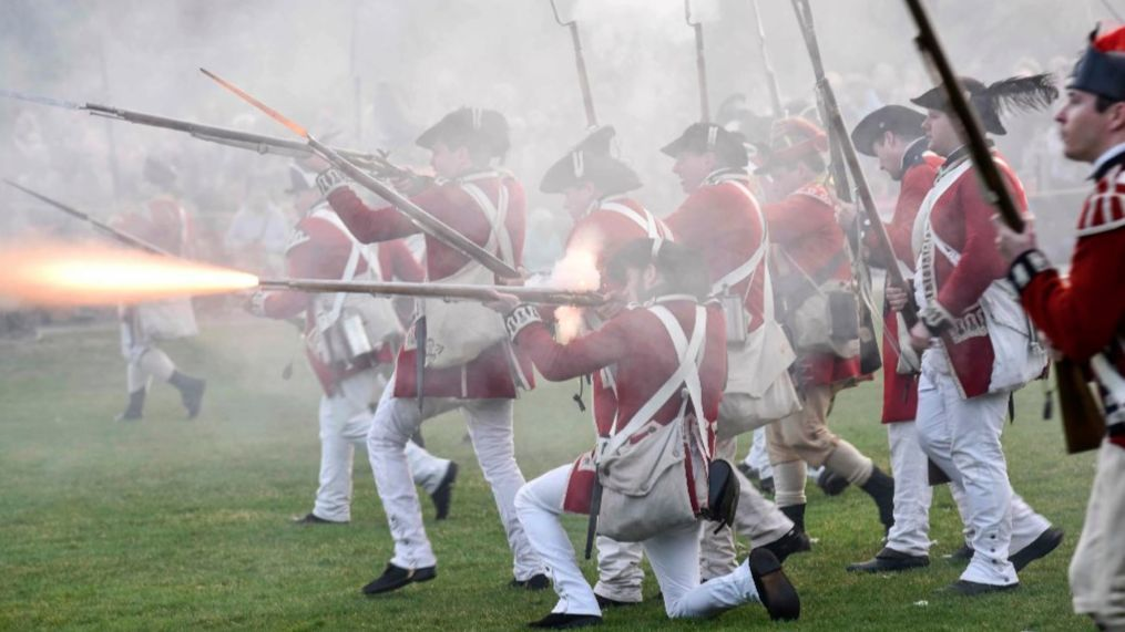 British troops fire on Continental Army soldiers during a Patriots' Day reenactment of the battles of Lexington and Concord, in Lexington, Mass.