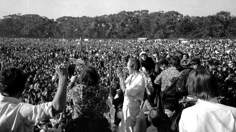 LSD guru Timothy Leary (at center in white) leads an estimated 15,000 people in song in San Francisc