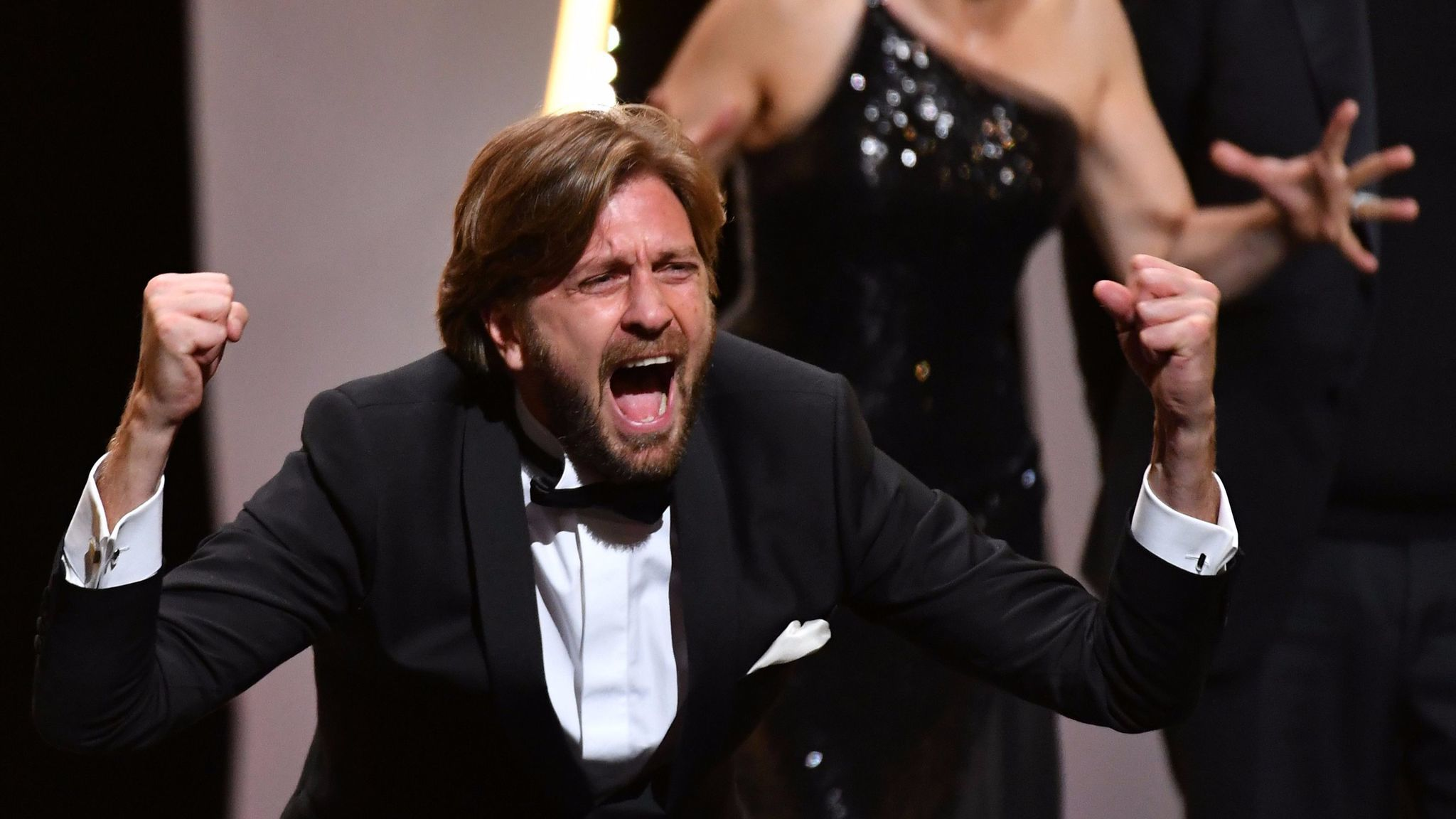 Swedish director Ruben Ostlund reacts on stage after he was awarded with the Palme d'Or for the film 'The Square' during the closing ceremony of the 70th edition of the Cannes Film Festival. (Alberto Pizzoli / AFP / Getty Images)