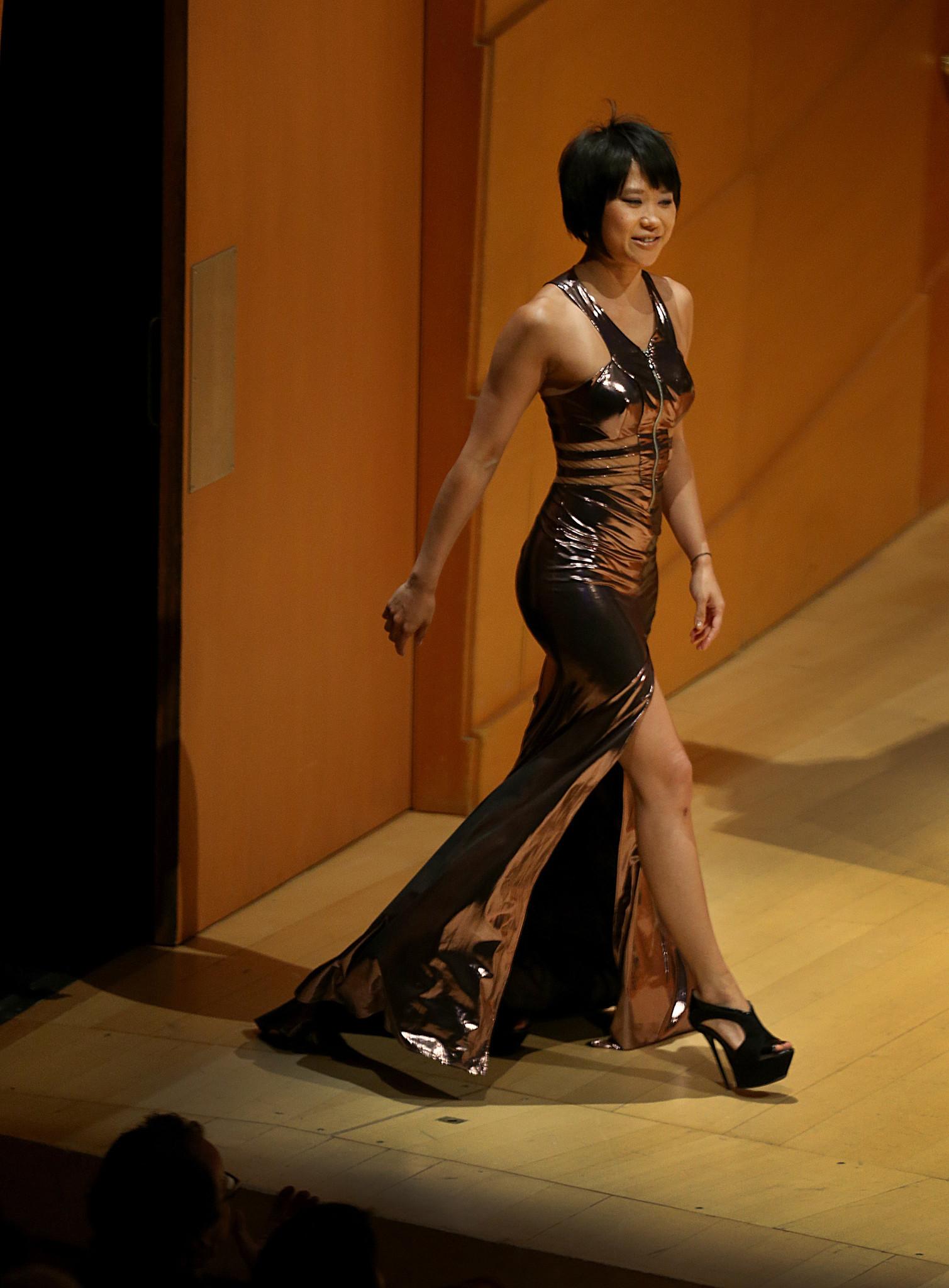 Pianist Yuja Wang makes her entrance Friday night at Walt Disney Concert Hall.