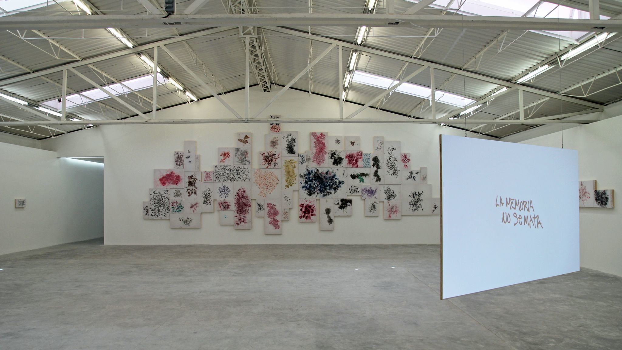 An installation view of work by Tercerunquinto at Proyectos Monclova, in Mexico City. The work reflects on graffiti painted in the wake of the disappearance of 43 students in Ayotzinapa.