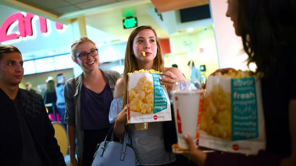 "Friends Max Dodd, left, Morgan Gerlach, Natalie Gold and Audrey Hattori grab popcorn before a screening of ""Baywatch"" in Santa Monica."