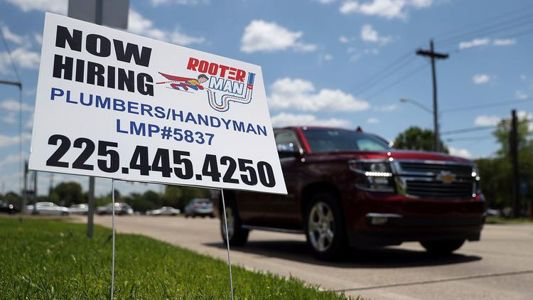 "A ""now hiring"" sign is seen in Baton Rouge, La., on May 5. (Justin Sullivan / Getty Images)"