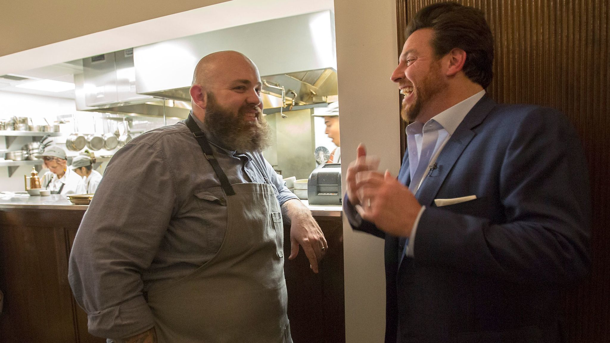 Chef and pasta maker Evan Funke (left) of Felix Trattoria chats with chef Scott Conant following dinner at the Venice restaurant.