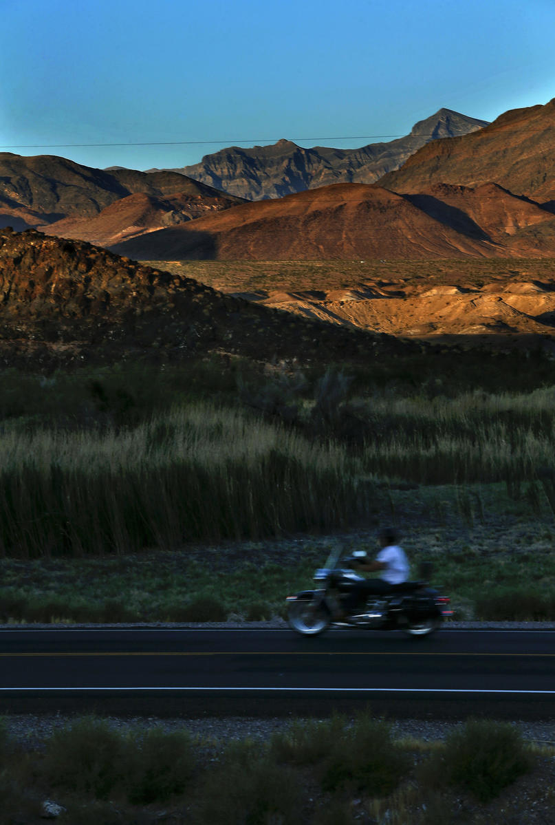 A motorcyclist rides along Highway 127 in Shoshone.