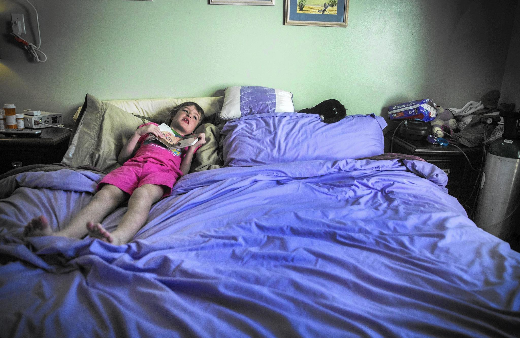 West Tarricone, 9, has a seizure in the bed she shares with her mother, Cara, at their Windham home in August 2016. They share a bed so Cara is close if West has a seizure in the middle of the night. West suffers from multiple seizure types, with some lasting seconds and others lasting more than hour. Some days she has hundreds, and even thousands, of seizures.