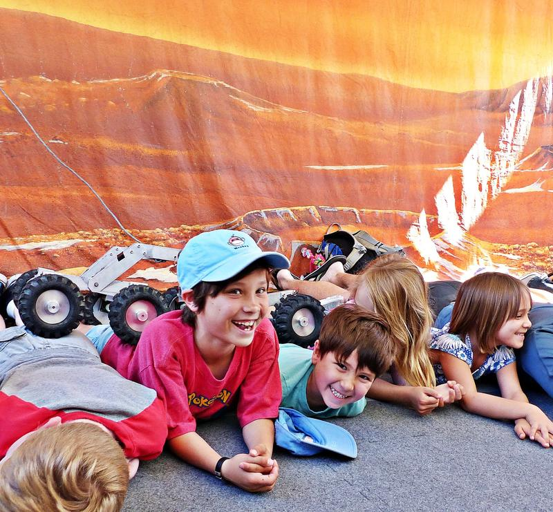 "On an open-house day at JPL, kids mimic the ""Martian"" landscape. (Sara Lessley/for the Times)"