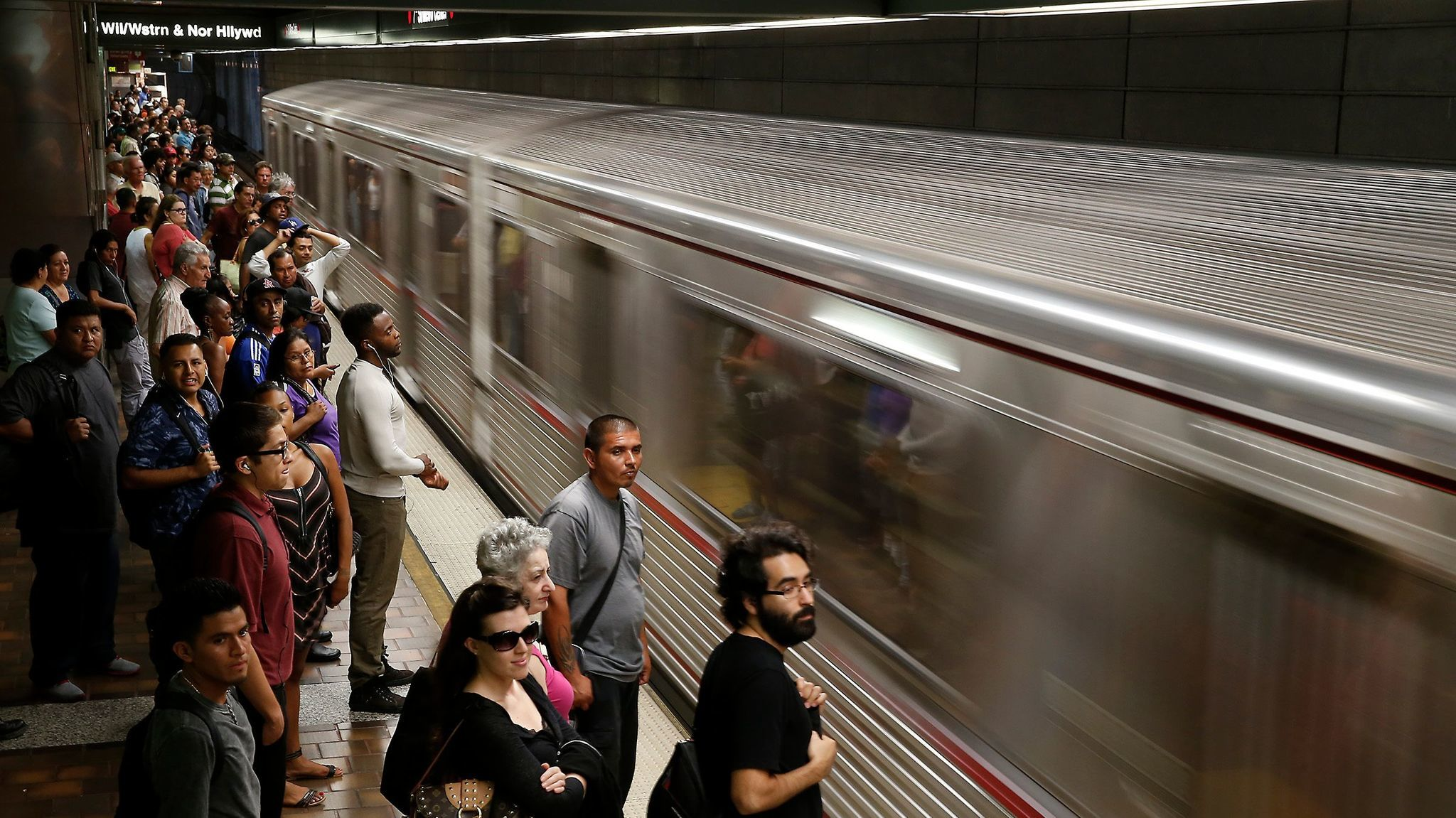 An eastbound train pulls in as commuters wait to board at the 7th Street Metro subway station in 2014.