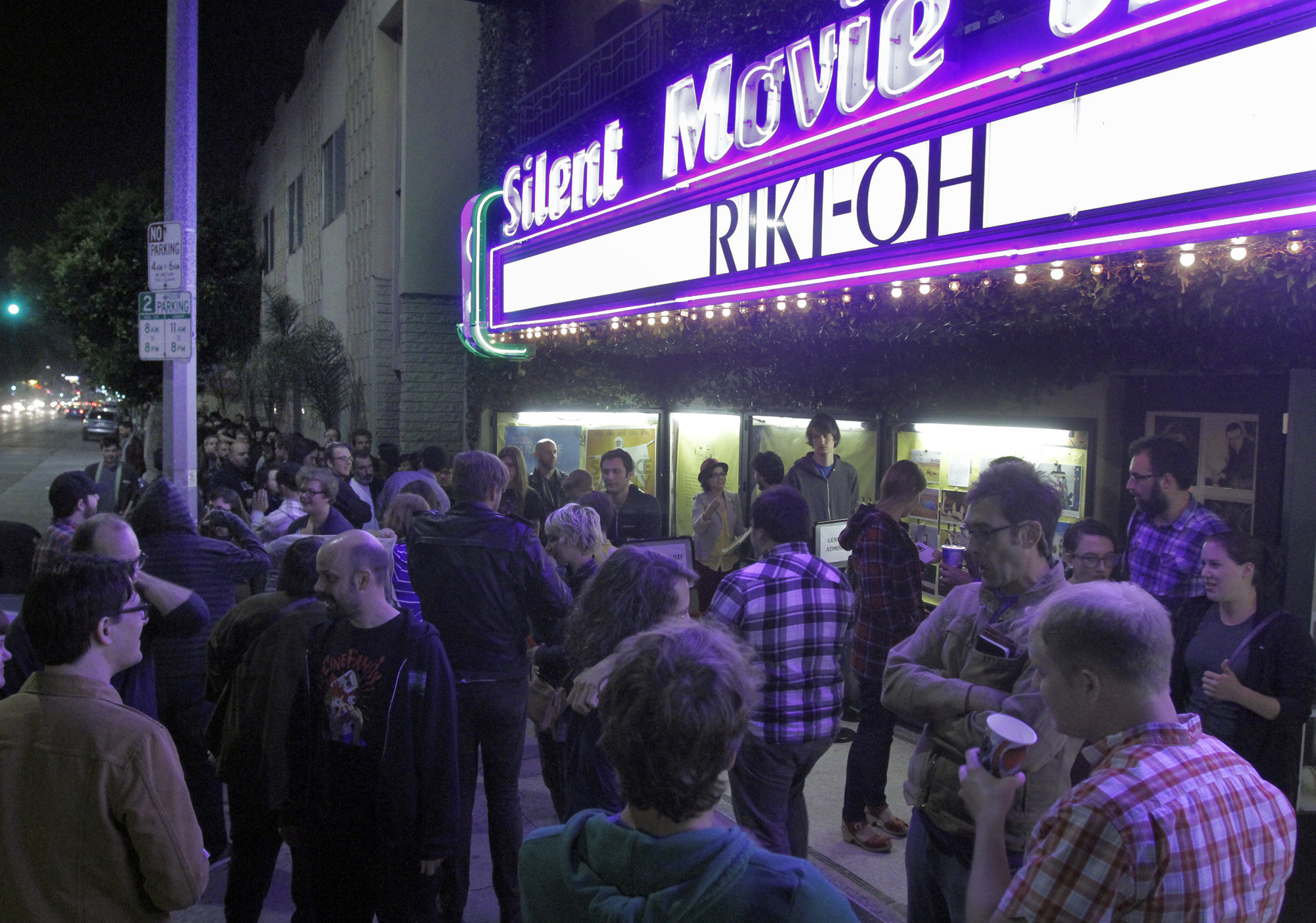 """Moviegoers line up before a midnight showing of the movie """"Riki-Oh"""" at the Cinefamily on L.A.'s Fairfax Avenue."""