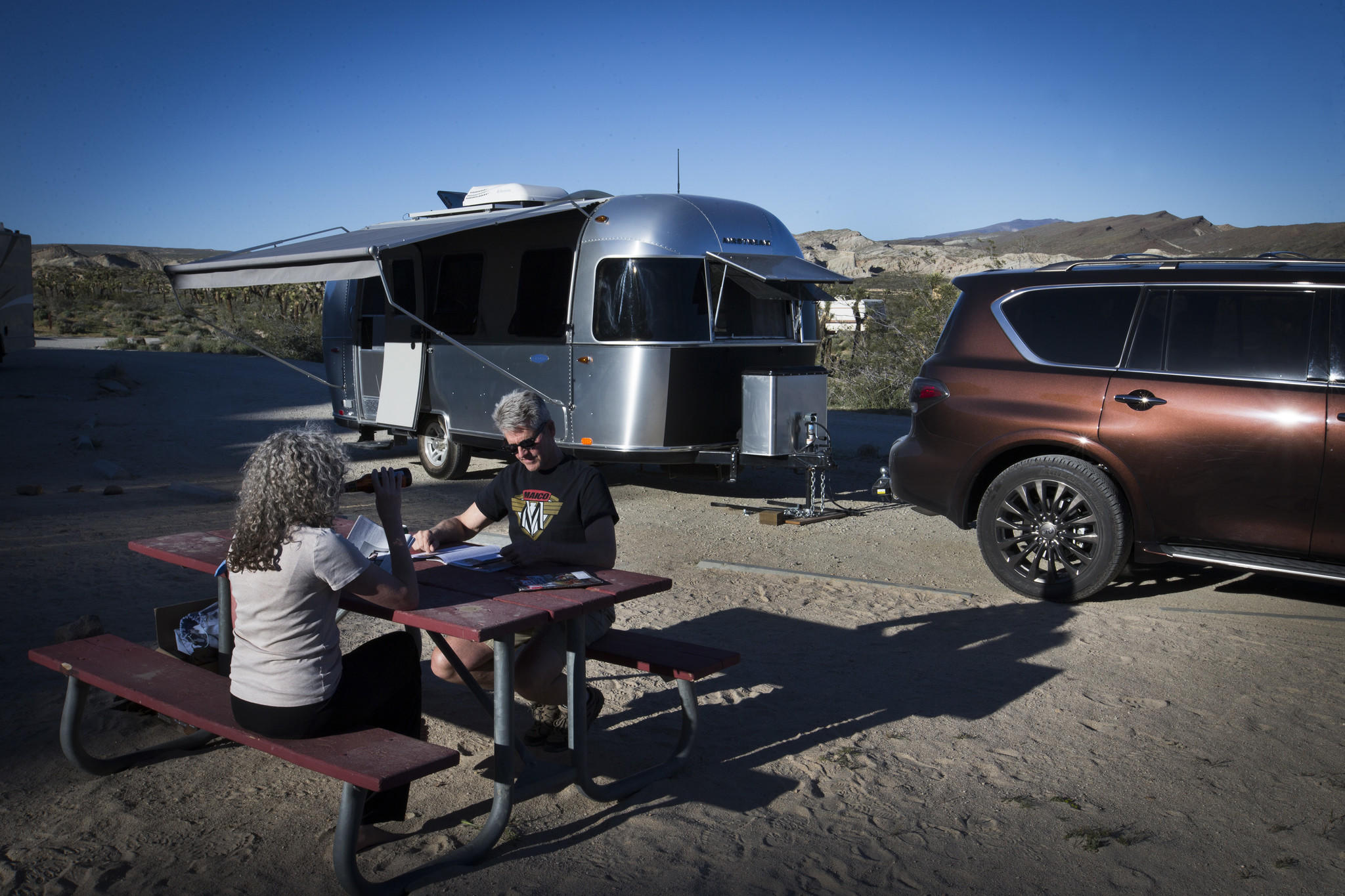 Charles and Julie Fleming camp in an Airstream Bambi Sport at Red Rocks Canyon Ricardo campground in Red Rocks Canyon State Park near Mojave. (Allen J. Schaben / Los Angeles Times)