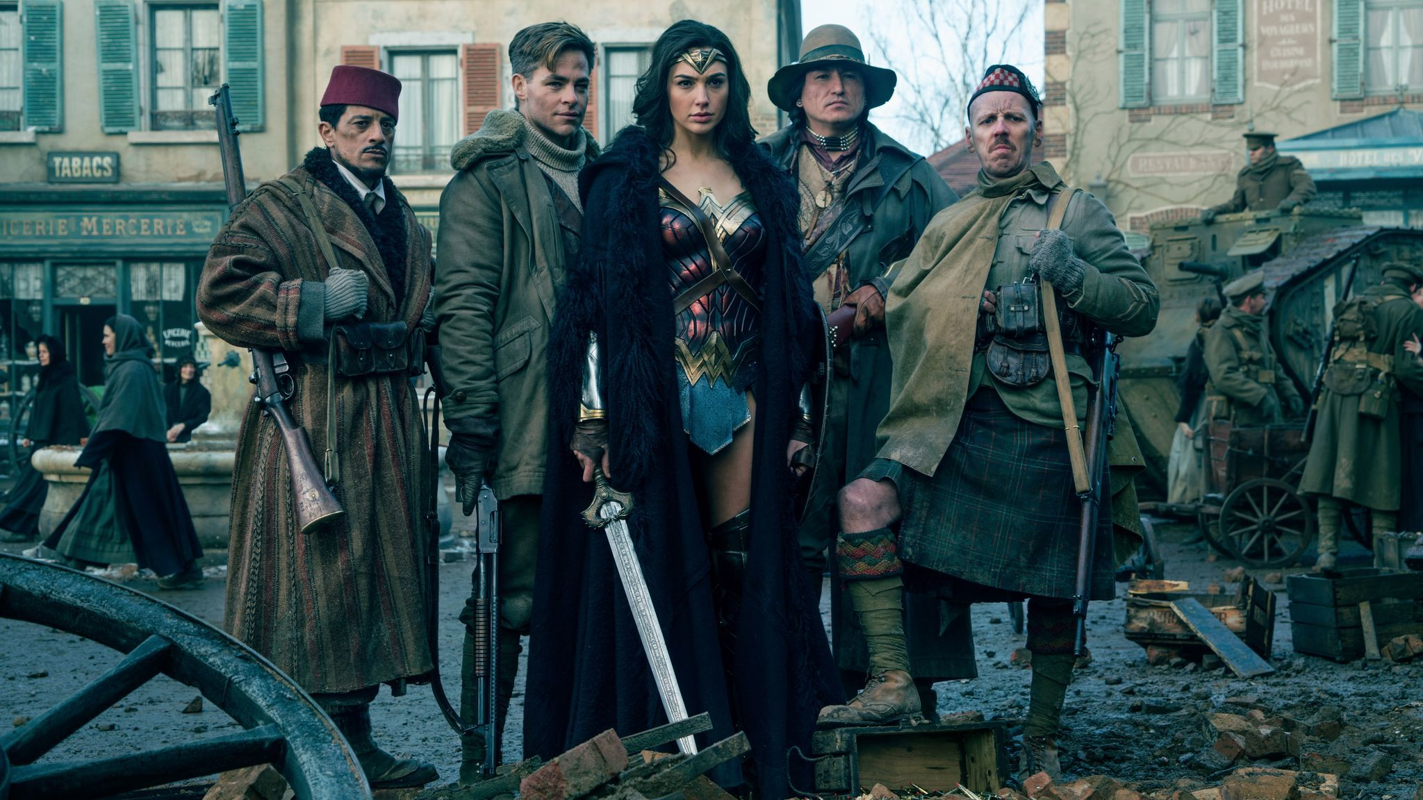 "Saïd Taghmadui as Sameer, Chris Pine as Steve Trevor, Gal Gadot as Wonder Woman, Eugene Brave Rock as the Chief and Ewen Bremner as Charlie in ""Wonder Woman."""