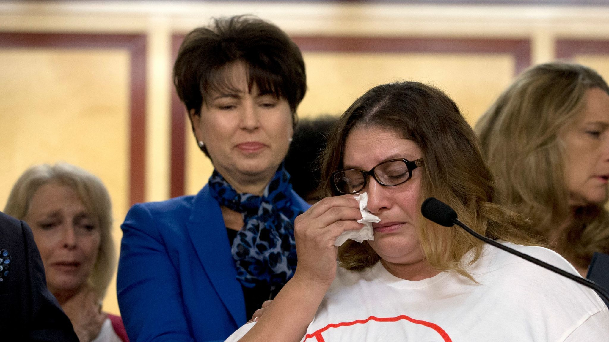 Norma Hernandez, backed by state Sen. Connie Leyva (D-Chino), wipes her eyes as she talks at a September 2016 news conference about being raped when she was 13. Leyva sponsored a bill that ended California's statute of limitation in some rape cases.