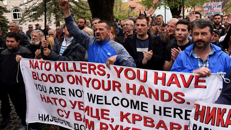 Anti-NATO demonstrators carry banners during a protest in April outside the Montenegro parliament in