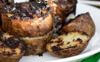 Grilled potatoes with parmesan, garlic and rosemary