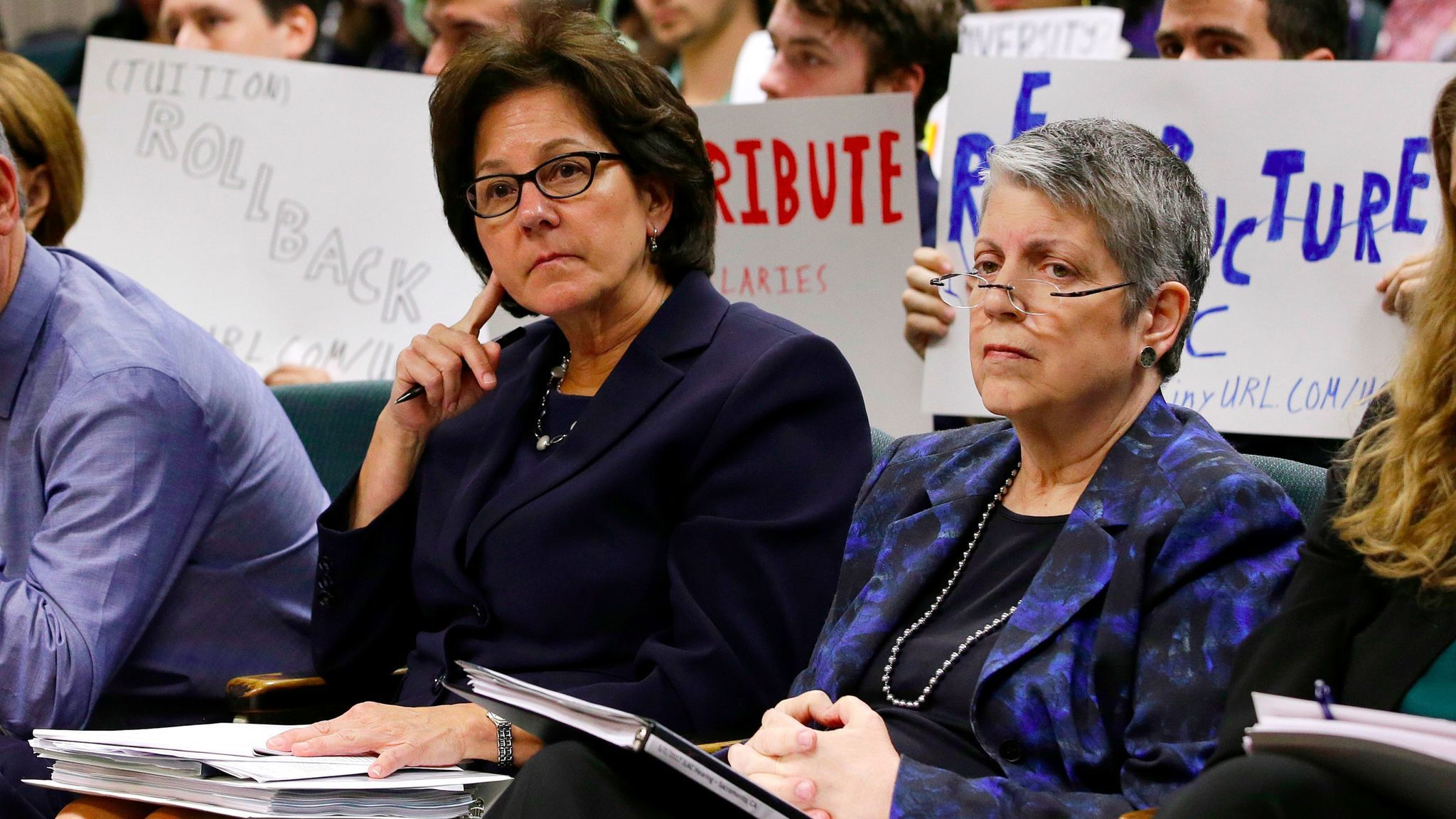 Monica Lozano, left, chair of the University of California Board of Regents, and UC President Janet Napolitano at a legislative hearing in the wake of a scathing audit on spending by Napolitano's office.